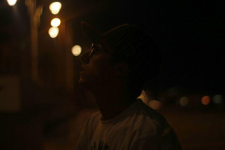 Close-up of illuminated man at night