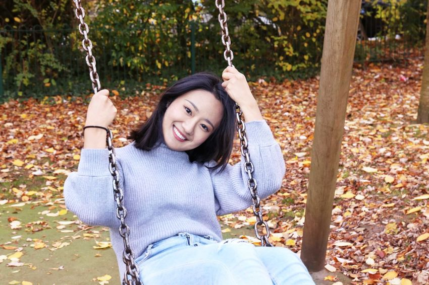 Autumn Mood Looking At Camera Portrait One Person Swing Smiling Young Adult Autumn Young Women Playground Day Lifestyles This Is Natural Beauty A New Perspective On Life