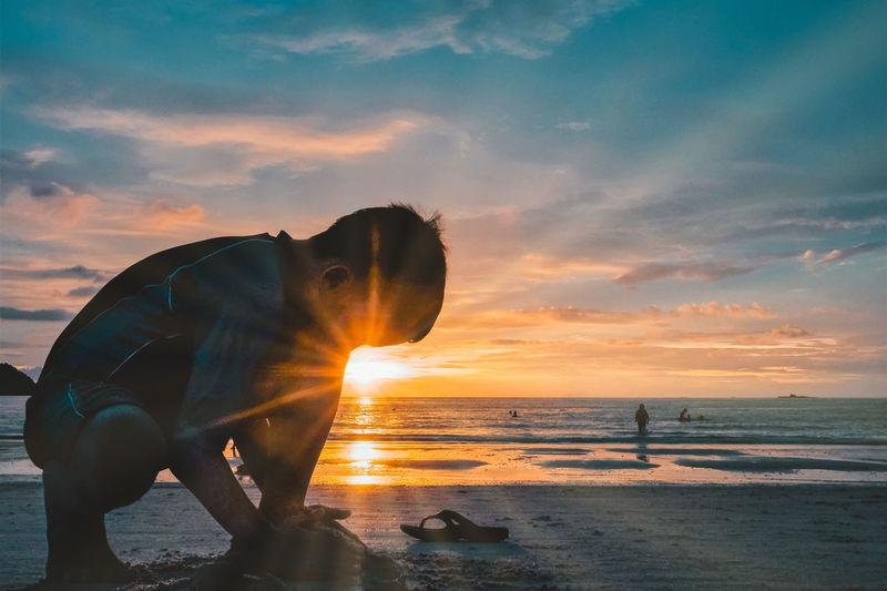 Pantai Cenang Langkawi Play On The Beach. Beach Beauty In Nature Boy On The Beach Child Childhood Cloud - Sky Golden Hour Horizon Horizon Over Water Langkawi Island Malaysia Leisure Activity Lifestyles Nature Outdoors Sea Sky Sun Sun Beams Sun Rays Sunlight Sunset HUAWEI Photo Award: After Dark Capture Tomorrow