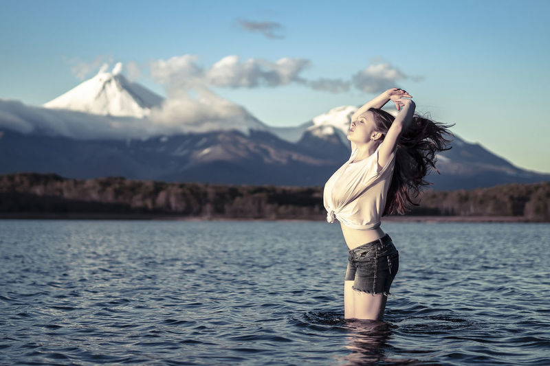Beautiful Woman Beauty In Nature Day Hair Hairstyle Lifestyles Mountain Mountain Peak Mountain Range Nature One Person Outdoors Scenics - Nature Sky Standing Tranquil Scene Tranquility Water Waterfront Women Young Adult Young Women