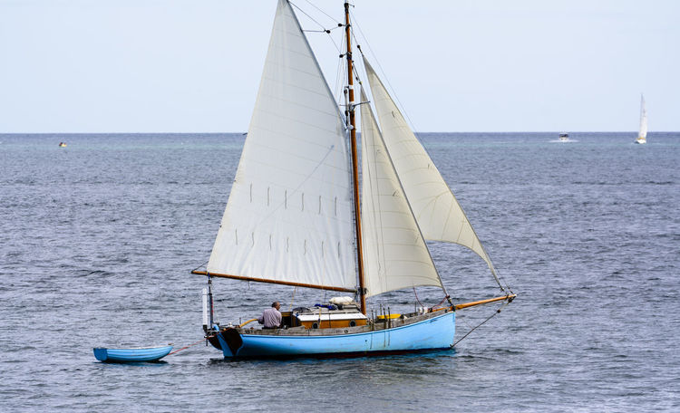An old sail boat in Falmouth Harbour, Cornwall, UK Beauty In Nature Blue Boat Calm Clear Sky Day Horizon Over Water Journey Mast Mode Of Transport Nature Nautical Vessel Ocean Outdoors Rippled Sailboat Sailing Scenics Sea Sky Tranquil Scene Tranquility Transportation Water Waterfront