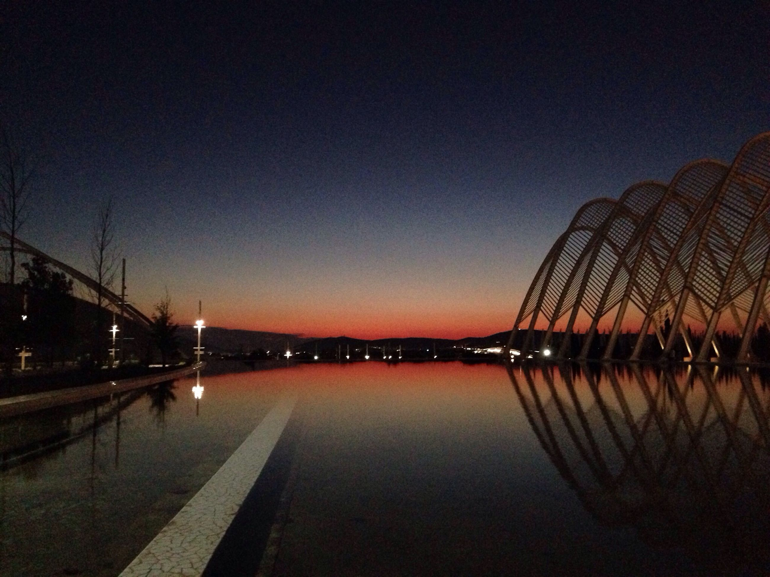 illuminated, night, clear sky, water, copy space, reflection, river, connection, bridge - man made structure, built structure, dusk, transportation, street light, tranquility, tranquil scene, lighting equipment, architecture, outdoors, bridge, waterfront