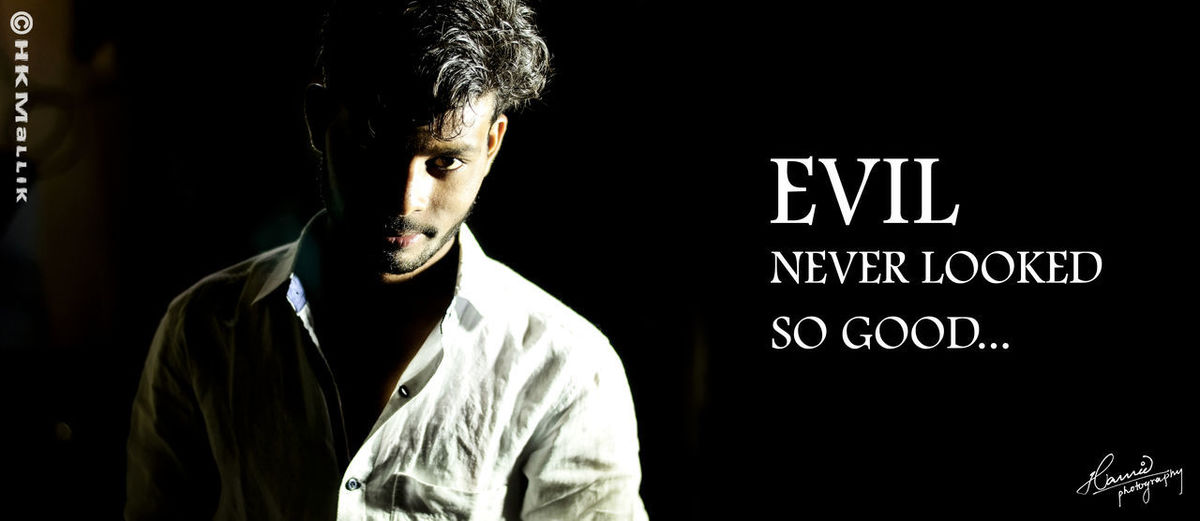 DNM Photography Dawood Nurson Mallik EVIL NEVER LOOKED SO GOOD... Night Photography Black Background Close-up Communication Dark Front View Hamid Photography Headshot Indoors  Lifestyles Looking At Camera Men One Person Portrait Text Waist Up Young Men
