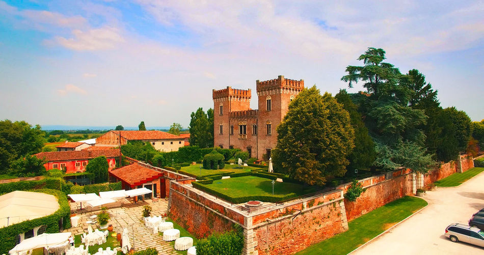 Verona, Italy - July 15, 2018: Beautiful old italian castle hosting wedding in the countryside. Aerial view. Aerial Beautiful Castle Drone  Europe Evening Event Flight Fort Fortress Happy Italian Italy Love Marry Nature Old Outdoor Party Scenic Tourism Travel View Wedding