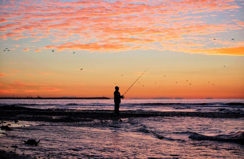 Fisherman Sea Water Sunset Sky Beauty In Nature Beach Real People Land Orange Color Scenics - Nature One Person Lifestyles Silhouette Leisure Activity Nature Horizon Over Water Standing Men Horizon Outdoors