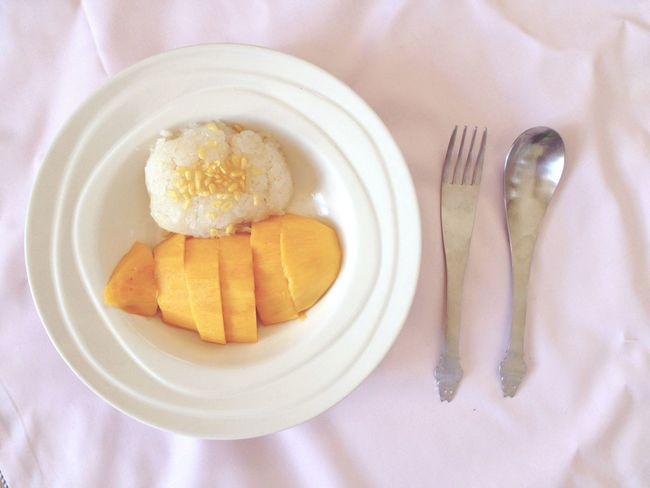 The most popular Thai dessert in Summer Fork Plate Food And Drink Table Knife Food Table Napkin No People Tablecloth Serving Size SLICE Place Setting Indoors  Freshness Ready-to-eat Eaten Close-up Day Mango Sticky Rice Thailand Dessert