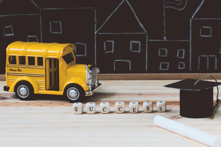 Education concept. Desk Graduating Graduation Scholar Blackboard  Car Chalk Chalk Drawing Chalkboard College Education Educational Graduate Knowledge Mortar Board Motor Vehicle School School Bus Success Successful Toy University Victory Wooden Yellow