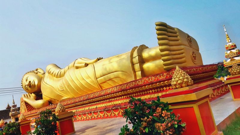 Big golden sleeping buddha Statue Statues In The Park Golden Buddha Sleeping Buddha Eyeem Photography Vientiane Laos Laos Travel The Week Of Eyeem Hello World Fresh On Eyeem  My Point Of View Feel The Journey Original Experiences Religion And Beliefs Gold Sculpture My Capture  Religion Buddhism Gold Colour 43 Golden Moments Big Statue Big Sleeping Buddha
