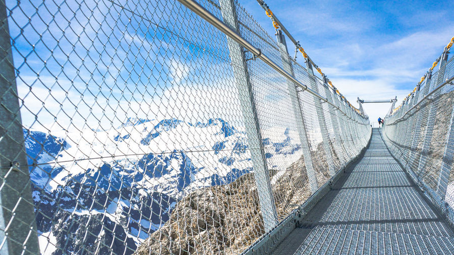 TITLIS Cliff Walk. Architecture Blue Bridge Bridge - Man Made Structure Built Structure Cable City Cliff Walk Cloud Cloud - Sky Cloudy Day Diminishing Perspective No People Outdoors Sky The Way Forward