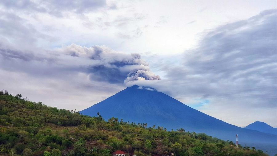 Mount Agung volcano in Bali, Indonesia. Bali Mount Agung Agung Mountain Agung Volcano Beauty In Nature Cloud - Sky Day Erupting Landscape Mountain Nature No People Outdoors Scenics Sky Tranquil Scene Tranquility Tree Volcano