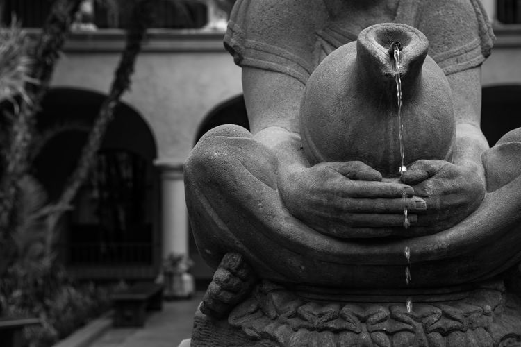 Drinking Water Drought Agua Bottled Water Close-up Conserve Water Day Drink Time Drink Water Human Hand Indoors  Lifestyles One Person People Real People Religion Save Water Sculpture Sitting Statue Water Water Conservation Water Drought Water Resources Water Saver