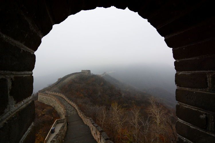 Walkway At Great Wall Of China During Foggy Weather Seen Through Arch