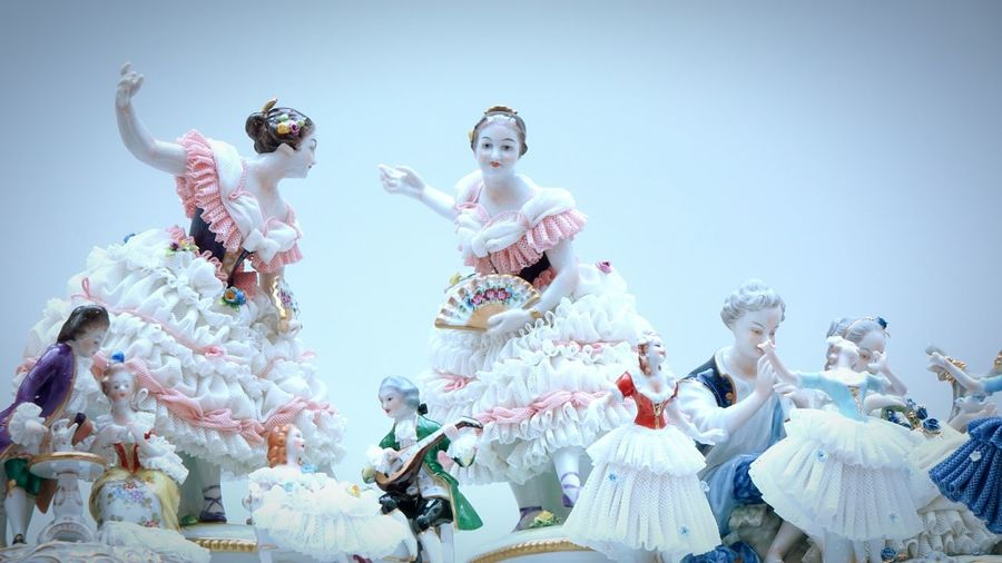 Close-up of figurines against white background