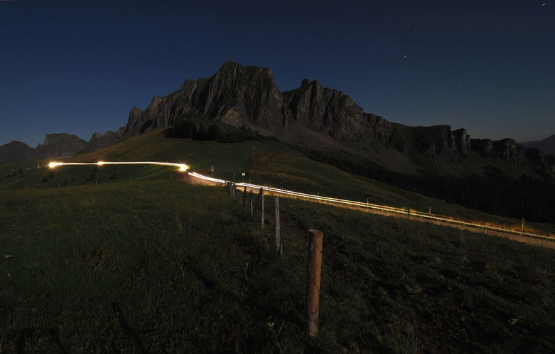 Mountain against clear sky at night
