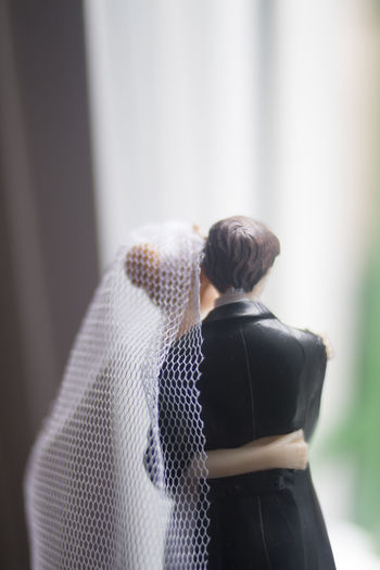 Close-up of couple figurines