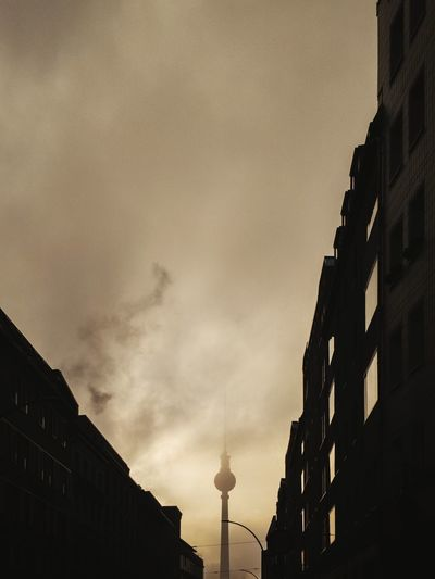 Apocalypse Berlin Winter Foggy Sunrise Berliner Ansichten Berlin Alexanderplatz Fernsehturm TV Tower Tv Tower Berlin That Tower Again Apocalypse Turbulent Distress Climate Change Morning Light Ligjt And Shadow The Way Forward City Cityscape Silhouette Illuminated Sky Architecture Building Exterior Built Structure Dramatic Sky Storm Cloud