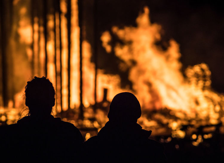 """Buergbrennen"" is a Luxembourg tradition, where bonfires are lit on the Sunday after Carnival to chase away the winter Buergbrennen Luxembourg Bonfire Burning Close-up Fire Flame Focus On Foreground Heat - Temperature Men Nature Night Outdoors People Real People Silhouette Sky"