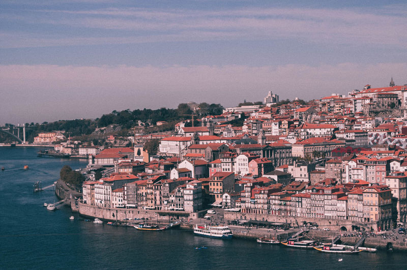 Aerial View Of Town By Sea Against Sky