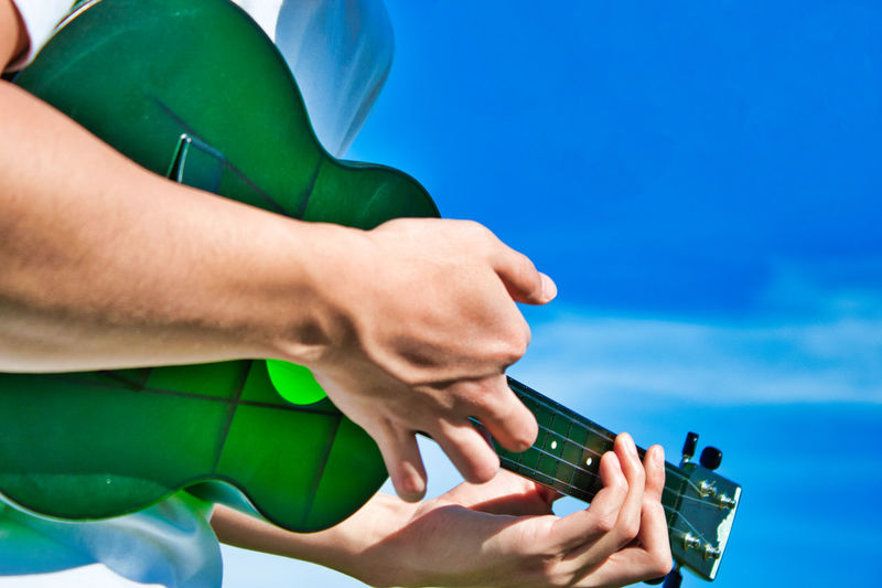 Clouds Guitar Hand Human Hand Instrument Nature One Person Outdoors Playing Sky Ukulele