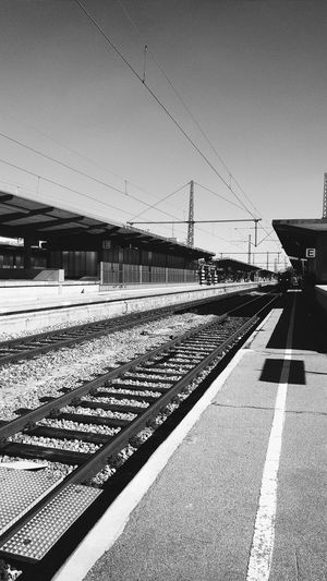 Railroad station against clear sky