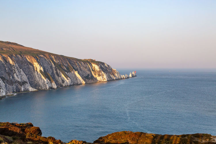 The Needles on the Isle of Wight, viewed from Alum Bay The Needles Isle Of Wight  Alum Bay Chalk Rock Formation Iconic Landmark Sea Water Sky Rock Nature Beauty In Nature Rock - Object Scenics - Nature Clear Sky Day Solid Mountain Tranquility Cliff No People Outdoors Formation