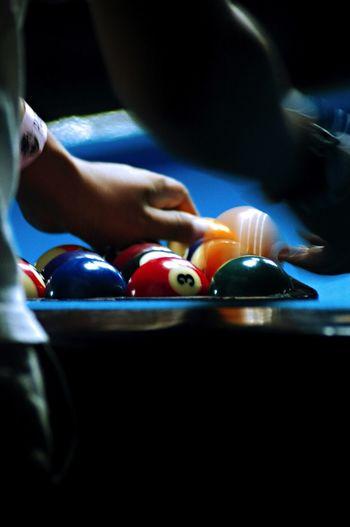 Person arranging snooker balls