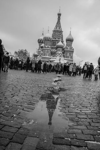 Architecture Built Structure Building Exterior Religion Place Of Worship City Spirituality Sky Belief Building Real People Wet Travel Destinations Rain Travel Street Incidental People Nature Paving Stone Cobblestone Rainy Season Outdoors St. Basil's Cathedral Dutch Angle Reflection