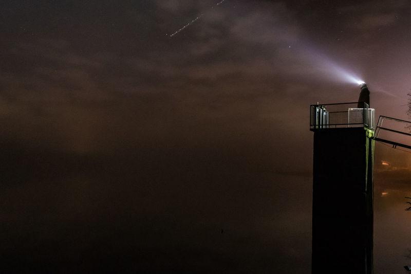 Stars, Fog & Light Lightbeam Cloud - Sky Fog Night No People One Person Sky Water