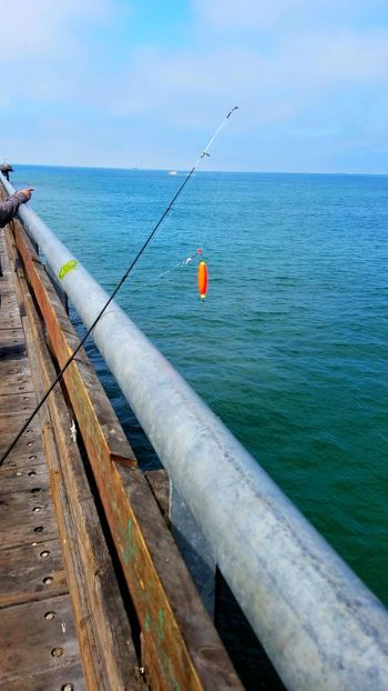 Fishing Lure Red Orange Fishing Pole Sea Water Horizon Over Water Outdoors Tranquility Rewilding Clouds Leisure Activity Ocean Copy Space Colorful Patterns Sunlight Nature Sport Backgrounds Togetherness Family Pasttime Let's Go. Together. Breathing Space