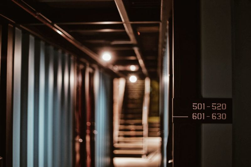 Corridors  Entryway Light Up Your Life Numbers Only Back Lit Background Bokeh Background Defocus Bokeh Communication Corridor Direction Entry Door Illuminated In A Row Indoors  Information Information Sign Light Path No People No People, Numbers Passageway Sign Text Western Script