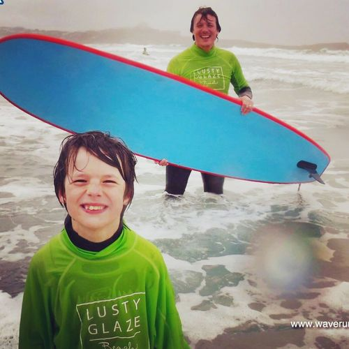 Leisure Activity Smiling Boys Front View Childhood Looking At Camera Real People Fun Happiness Lifestyles Portrait Elementary Age Enjoyment Day Cheerful Togetherness Beach Two People Outdoors Vacations Surfer Surfing Water_collection Family Time Love