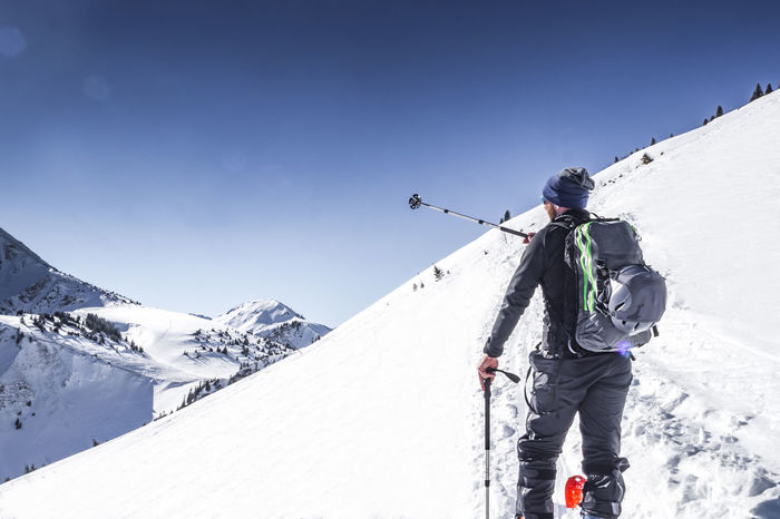 Ski tourer on his way to the peak Allgäu Guiding Hiking Man Ski Touring Skiing Adventure Alps Ascent Avalanche Airbag Bayern Bschiesser Climbing Freeskiing Guide Lifestyles Mountain Guide Oberjoch Ski Ski Mountaineering Ski Tourer Snow Tour Vacations Winter