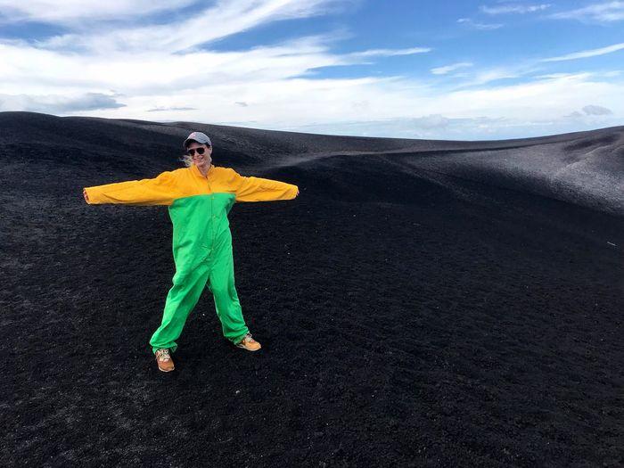 One Person Full Length Cloud - Sky Sky Landscape Lifestyles Scenics Dynamic Scenery Determination Energy Lava Field Lava Rocks Volcano Rock Volcano Crater Adrenaline Junkie Adventure CerroNegro Extreme Sports Nicaragua VolcanoBoarding Jumpsuit
