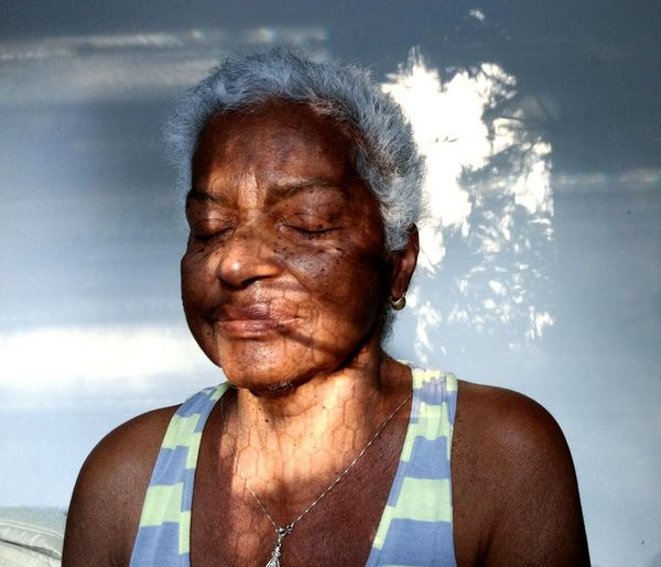 mapping face darkness and light Faces Of EyeEm Faces Of Africa Brasilian Womam Eyeem Market This Is Aging Human Hand Portrait Headshot Front View Sky Close-up Cloud - Sky Power In Nature Double Exposure Pretty Environmentalist Multiple Exposure Lightning