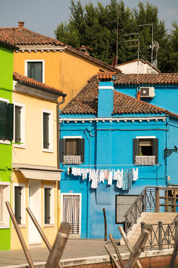 A Day in Burano Architecture Blue Building Exterior Colourful Houses Little Bridge Over Canal No People Outdoors Sunlight Travel Destination Travel Destinations Travel Photography Washing Day