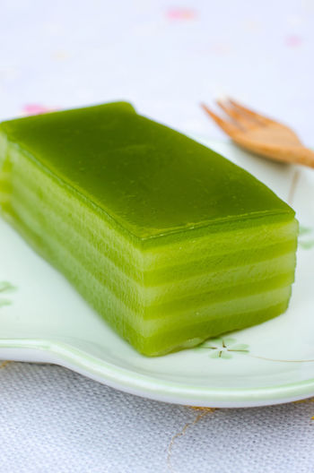 Thai's traditional layer dessert called KANOM CHUN Arrowroot Asian Food Close-up Delicious Dessert Flavor Freshness Green Color Homemade Food Jelly KANOM CHUN Natural No People Original Pandan Leaves Tapioca Flour Tastyfood Thai Layer Pudding Thailand Food Traditionalfood