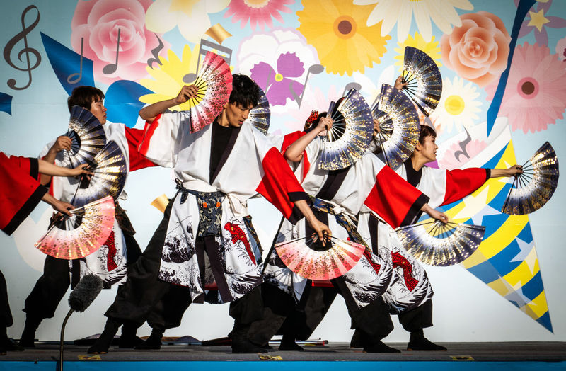 Real People Group Of People Arts Culture And Entertainment Celebration Clothing Costume Performance People Traditional Clothing Men Crowd Traditional Festival Togetherness Full Length Lifestyles Dancing Standing Festival Traditional Dancing Marching Band