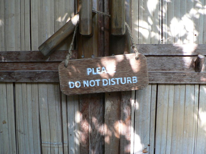 Close-up of text hanging on wood