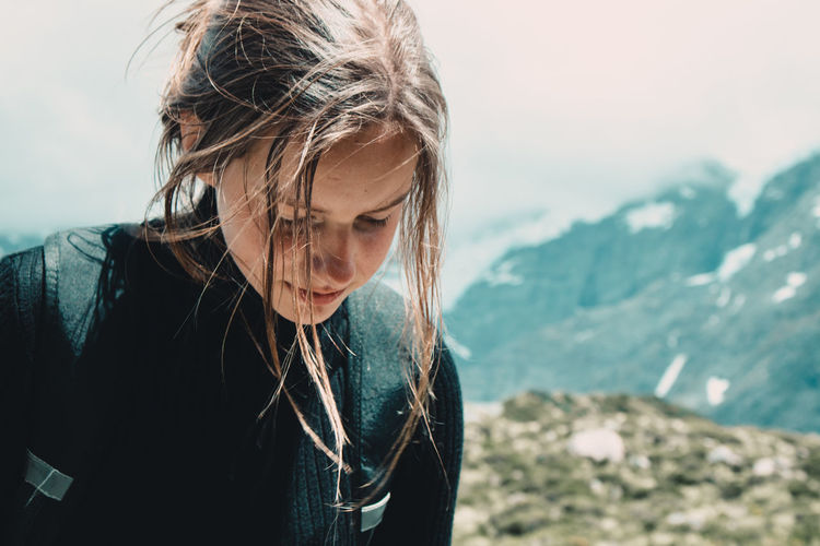 Mount Cook, New Zealand One Person Mountain Lifestyles Real People Leisure Activity Hair Portrait Focus On Foreground Young Adult Looking Down Headshot Young Women Blond Hair Looking Day Nature Women Hairstyle Outdoors Contemplation