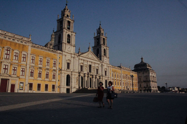 Convento De Mafra Architecture Building Exterior Built Structure City Clear Sky Day History Leisure Activity Men Outdoors People Real People Sky Togetherness Tourism Travel Travel Destinations Women