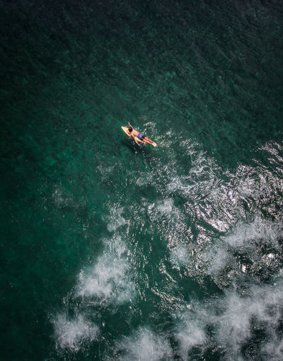 High angle view of people on sea. surfing