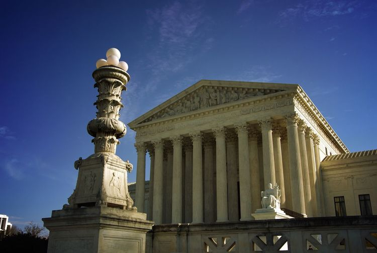 Front steps of Greek classical style United States Supreme Court building in Washington DC Statue Low Angle View Architecture Sculpture Built Structure Architectural Column Sky History Building Exterior Outdoors No People Travel Destinations Day Law Justice Judge Lawyer Law Ruling Fair Government United States Capital