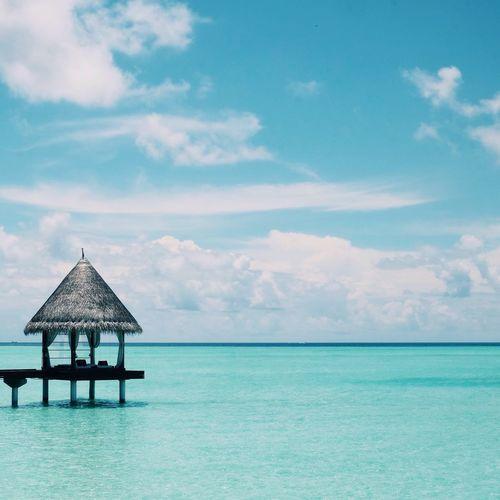 Stilt House In Sea