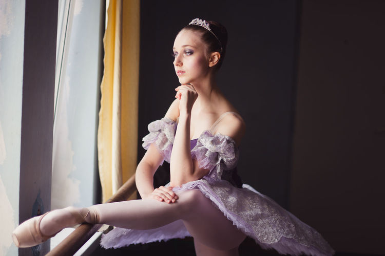 Ballerina Ballerina Girl Beauty Casual Clothing Confidence  Contemplation Fashion Fashion Model Femininity Front View Leisure Activity Lifestyles Person Pointe Shoes Portrait Sensuality Sleeveless  Window Young Adult Young Women