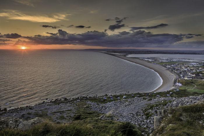Sunset over Chesil Beach. Dorset Coast Orange Sky Portland Road Weymouth Dorset Chesil Beach Chesilbeach Island Last Hour Before Sunset Sea And Sky Sunset Waterfront