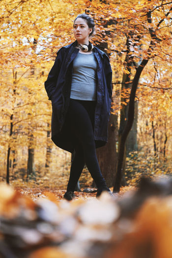 Tree Autumn One Person Full Length Young Adult Real People Lifestyles Leaf Leisure Activity Young Women Front View Forest Nature Day Outdoors Beautiful Woman Leaves Walking Walk Fall Woodlands Candid Low Angle View