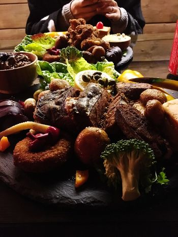 Food And Drink Food Real People Human Hand Freshness Human Body Part Indoors  Table Plate Holding Healthy Eating Women Meat Men Lifestyles Ready-to-eat Close-up Day People