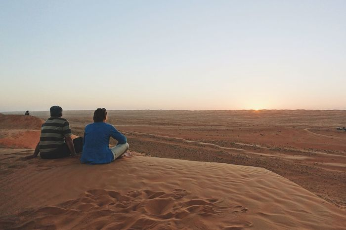 Rear View Oman Clear Sky Sitting Lifestyles Sand Desert Idyllic Women Men Scenics Arid Climate Beauty In Nature Sunset Nature Outdoors Leisure Activity Sky From My Point Of View Watching The Sunset Couple Romantic Naturelovers Travel Vacations The Great Outdoors - 2017 EyeEm Awards