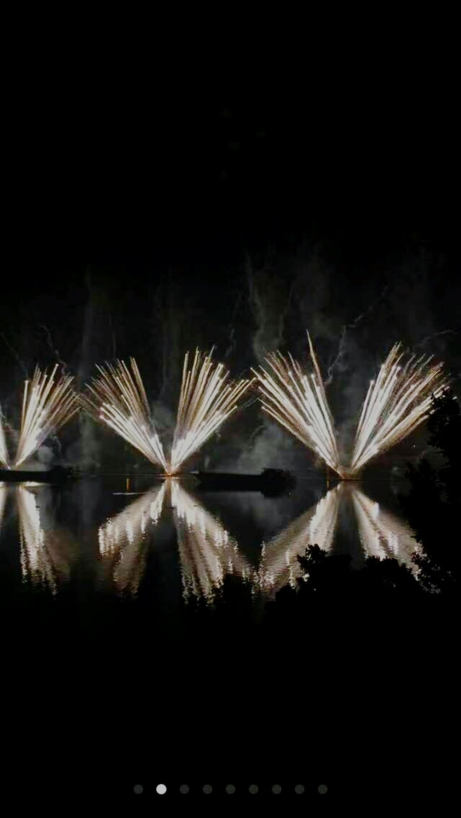 night, celebration, firework display, exploding, long exposure, illuminated, motion, no people, firework - man made object, outdoors, smoke - physical structure, sky