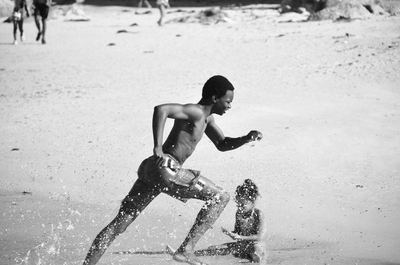 Young Man Running On Beach